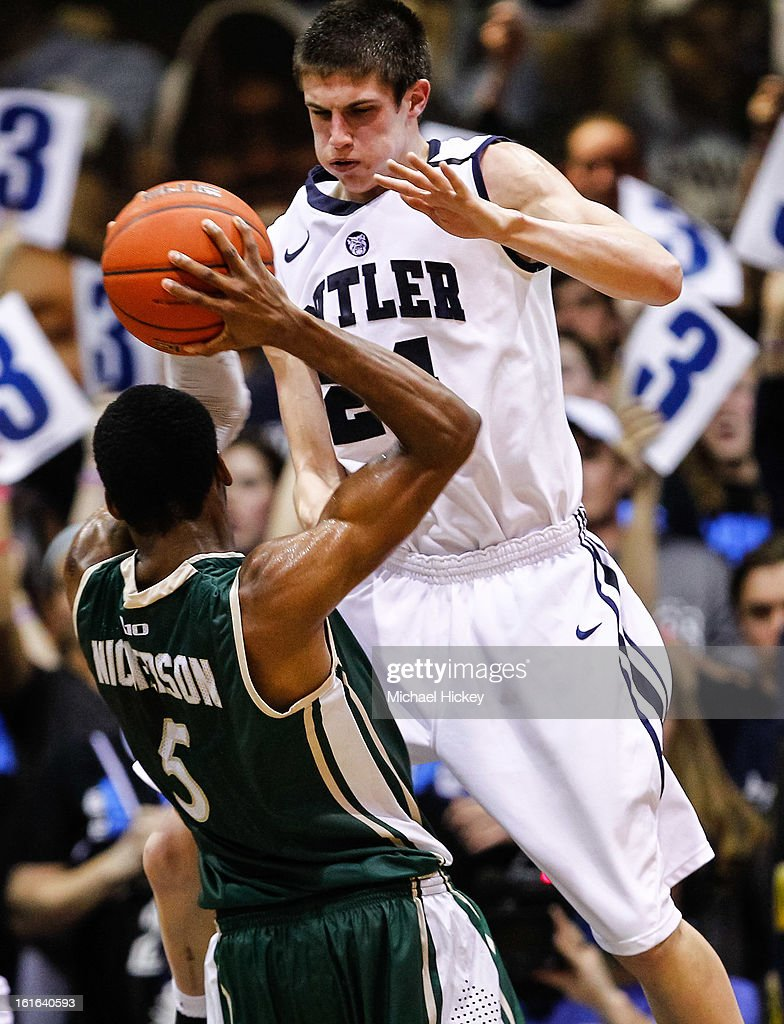 Kellen Dunham #24 of the Butler Bulldogs defends as E. Victor Nickerson #5 of the Charlotte 49ers holds the ball at Hinkle Fieldhouse on February 13, 2013 in Indianapolis, Indiana. Charlotte defeated Butler 71-67.