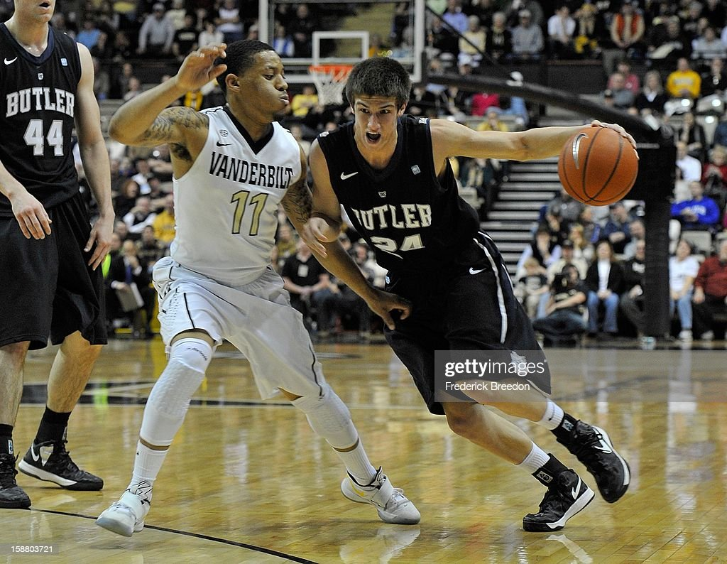Kellen Dunham #24 of the Butler Bulldogs drives toward Kyle Fuller #11 of the Vanderbilt Commodores at Memorial Gym on December 29, 2012 in Nashville, Tennessee.