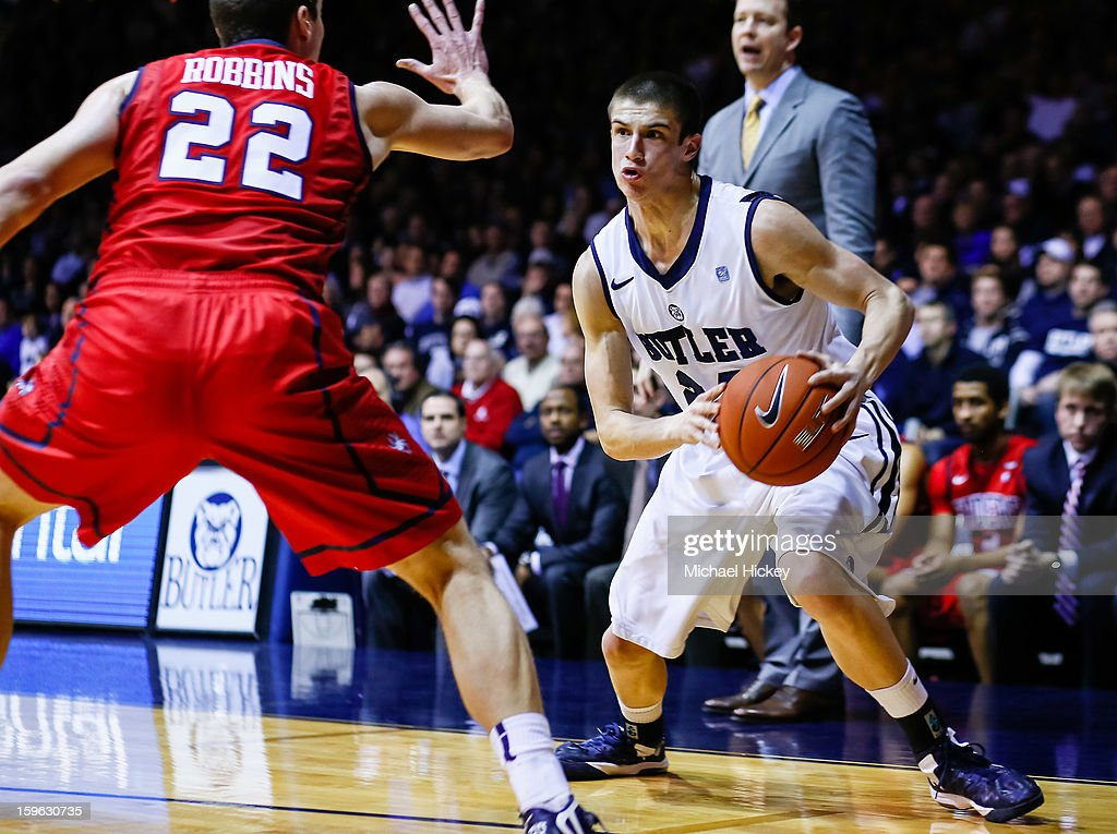 Kellen Dunham #24 of the Butler Bulldogs makes a move toward the baseline as Greg Robbins #22 of the Richmond Spiders defends at Hinkle Fieldhouse on January 16, 2013 in Indianapolis, Indiana. Butler defeated Richmond 62-47.