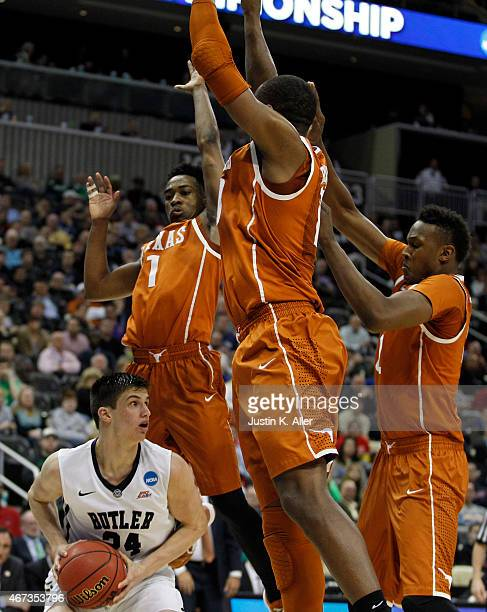 Kellen Dunham of the Butler Bulldogs plays against Jonathan Holmes Myles Turner and Isaiah Taylor of the Texas Longhorns during the second round of...