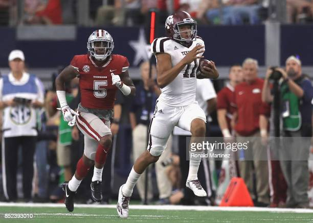 Kellen Mond of the Texas AM Aggies runs for 79 yards in the second quarter against the Arkansas Razorbacks at ATT Stadium on September 23 2017 in...