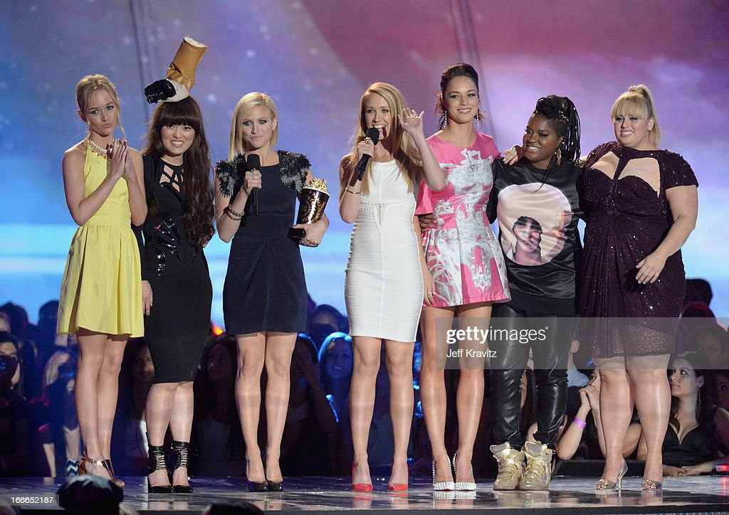 Kelley Jakle, Hana Mae Lee, Brittany Snow, Anna Camp, Alexis Knapp, Ester Dean, and Rebel Wilson accept the award for Best Musical Moment onstage during the 2013 MTV Movie Awards at Sony Pictures Studios on April 14, 2013 in Culver City, California.