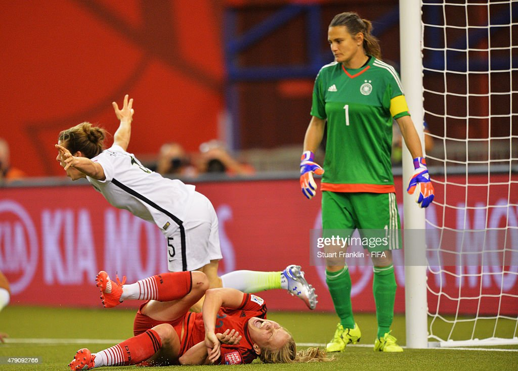Kelley O Hara of USA clebrates scoring her goal as Tabae Kemme of Germany lays injured on the pitch during the FIFA Women's World Cup Semi Final match between USA and Germany at Olympic Stadium on June 30, 2015 in Montreal, Canada.