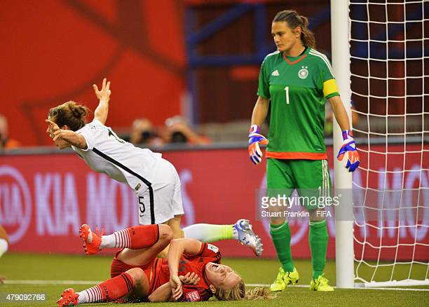 Kelley O Hara of USA clebrates scoring her goal as Tabae Kemme of Germany lays injured on the pitch during the FIFA Women's World Cup Semi Final...