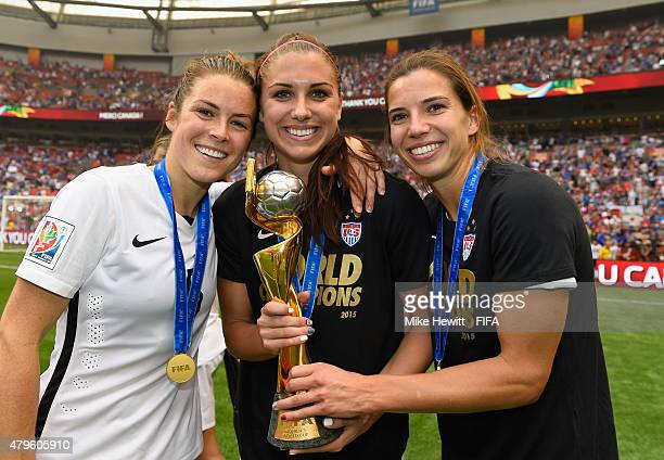 Kelley O'Hara Alex Morgan and Tobin Heath of USA hold the Winner's Trophy after the FIFA Women's World Cup 2015 Final between USA and Japan at BC...