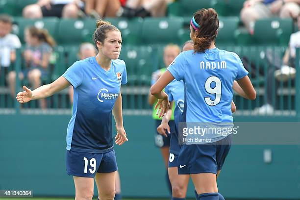 Kelley O'Hara of Sky Blue FC celebrates a goal with Nadia Nadim during the first half against the Western New York Flash at Sahlen's Stadium on July...