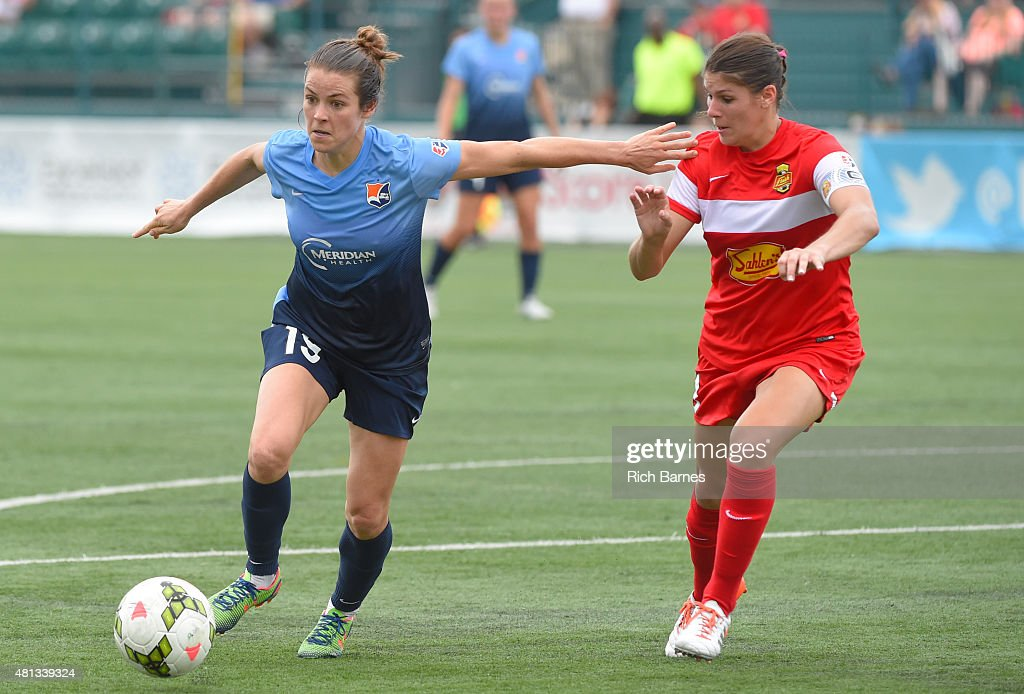 Kelley O'Hara #19 of Sky Blue FC controls the ball against the defense of Brittany Taylor #13 of Western New York Flash during the second half at Sahlen's Stadium on July 19, 2015 in Rochester, New York. The Sky Blue FC and the Western New York Flash played to a 0-0 draw.