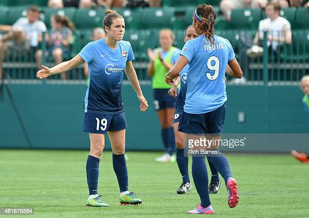 Kelley O'Hara of the Sky Blue FC celebrates a goal with teammate Nadia Nadim against the Western New York Flash during the first half at Sahlen's...