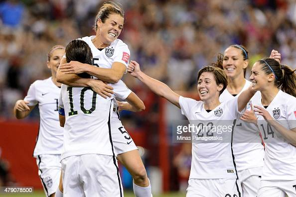 Kelley O'Hara of the United States celebrates with teammates after scoring a goal in the second half against Germany in the FIFA Women's World Cup...