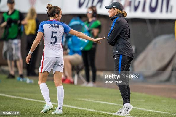 Kelley O'Hara of the US Women's National Team talks to head coach Jill Ellis during the second half of a friendly match against Japan on June 5 2016...