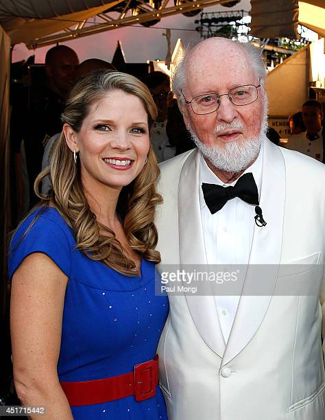 Kelli O'Hara poses for a photo with Conductor John Williams at PBS's 2014 A CAPITOL FOURTH at US Capitol West Lawn on July 4 2014 in Washington DC