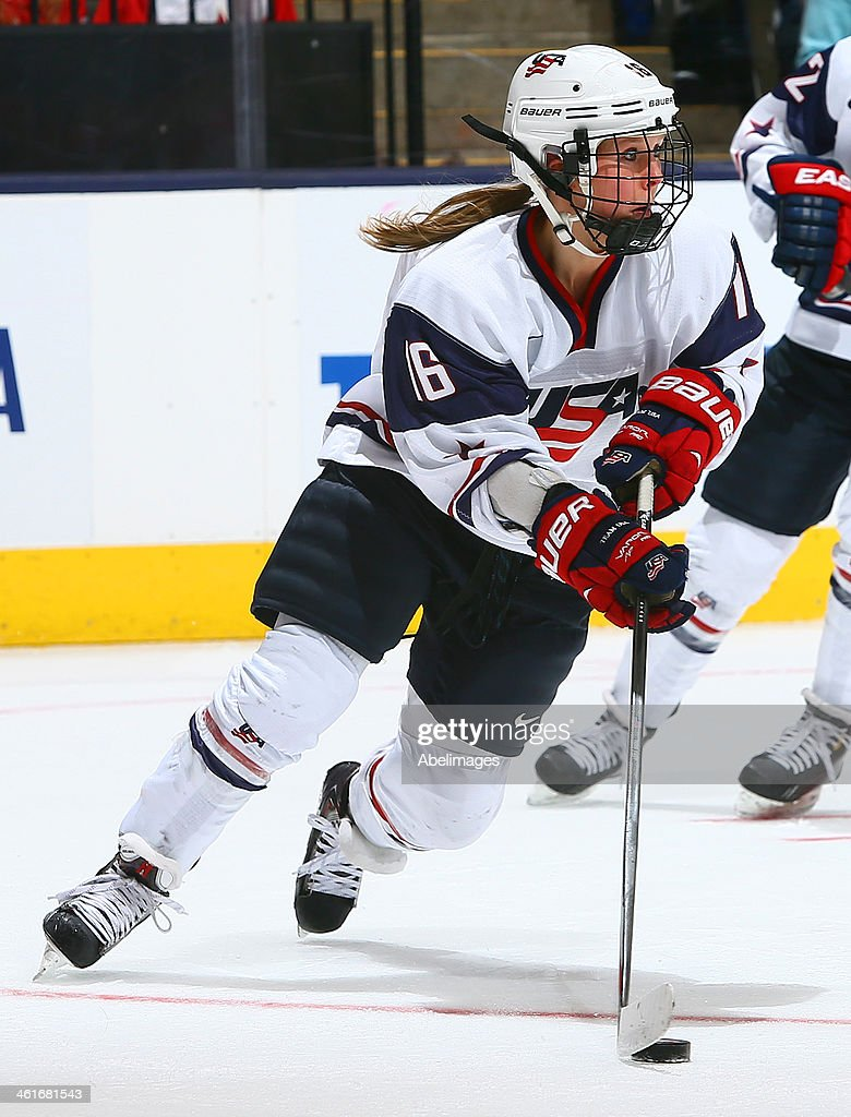 <a gi-track='captionPersonalityLinkClicked' href=/galleries/search?phrase=Kelli+Stack&family=editorial&specificpeople=6214354 ng-click='$event.stopPropagation()'>Kelli Stack</a> #16 of Team USA carries the puck against Team Canada during a Sochi preparation game at the Air Canada Centre December 30, 2013 in Toronto, Ontario, Canada.