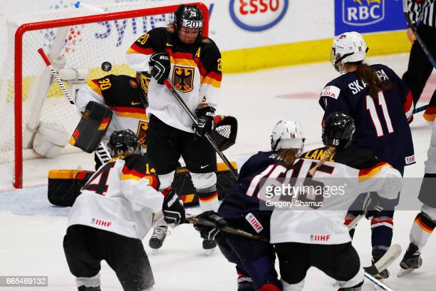 Kelli Stack of the United States watches her firstperiod goal float past Daria Gleissner of Germany during a semifinal game at the 2017 IIHF Woman's...