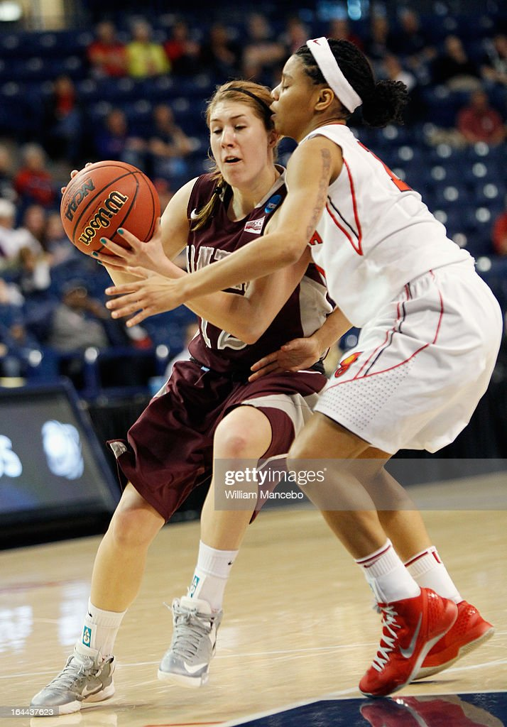 Kellie Cole #12 of the Montana Grizzlies plays against guard Tiaria Griffin #11 of the Georgia Lady Bulldogs during the game at McCarthey Athletic Center on March 23, 2013 in Spokane, Washington. The Lady Bulldogs defeated the Grizzlies 70-50.