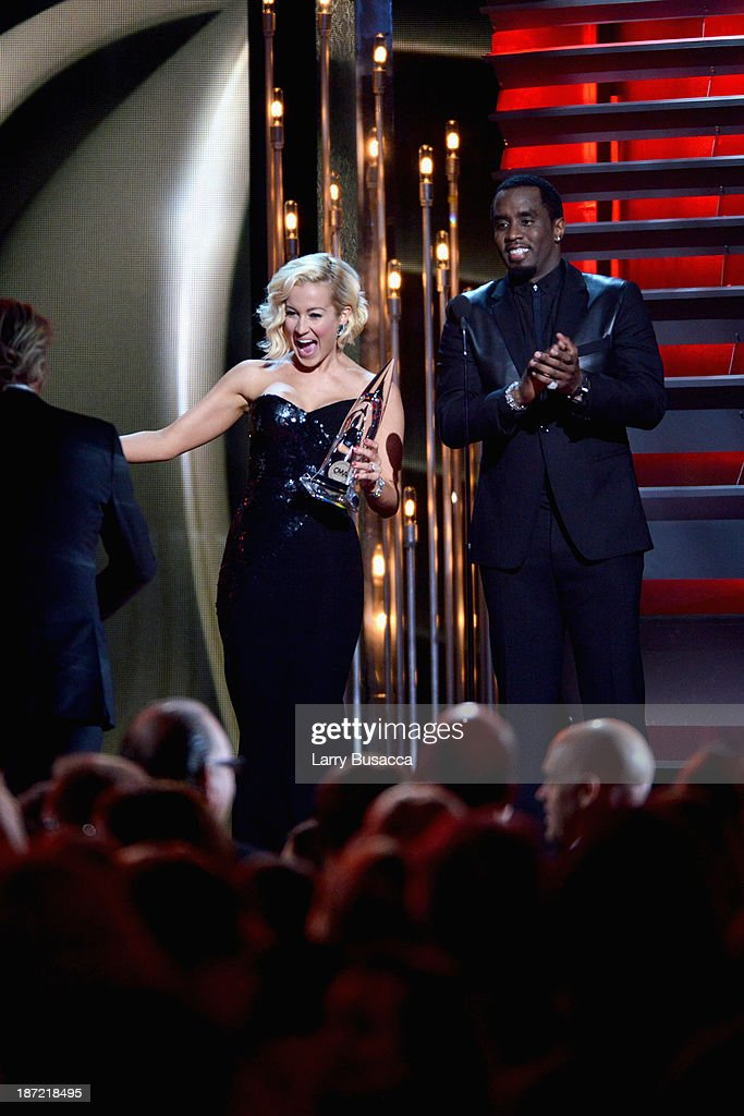 Kellie Pickler (L) and Sean Combs perform onstage during the 47th annual CMA awards at the Bridgestone Arena on November 6, 2013 in Nashville, United States.