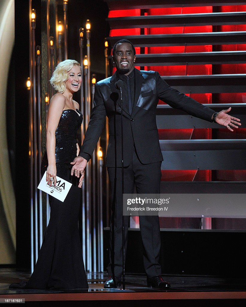 Kellie Pickler and Sean 'Diddy' Combs on stage during the 47th annual CMA awards at the Bridgestone Arena on November 6, 2013 in Nashville, Tennessee.