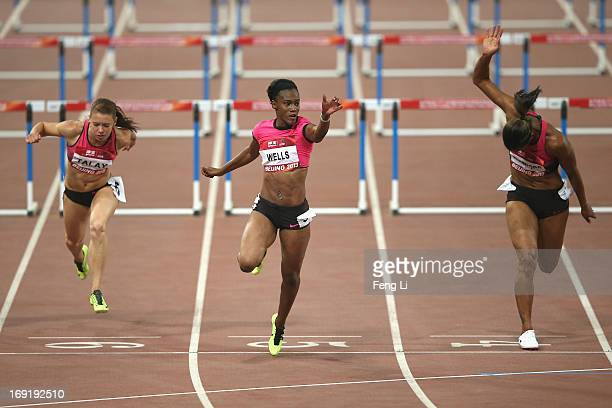 Kellie Wells and Virginia Crawford of United States complete in the Women's 100 Metres Hurdles at National Stadium also known as Bird's Nest during...