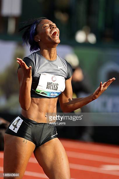 Kellie Wells celebrates after qualifying for the Olympics by coming in second in the women's 100 meter hurdles final during Day Two of the 2012 US...