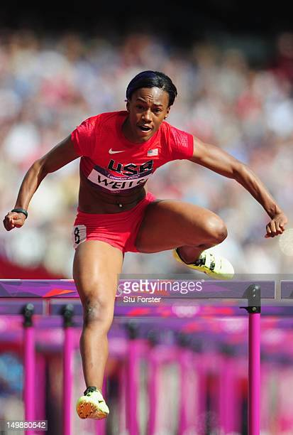 Kellie Wells of the United States comeptes in the Women's 100m Hurdles heat on Day 10 of the London 2012 Olympic Games at the Olympic Stadium on...