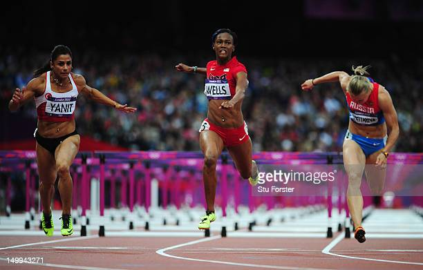 Kellie Wells of the United States leads Nevin Yanit of Turkey and Tatyana Dektyareva of Russia competing in the Women's 100m Hurdles Semifinals on...
