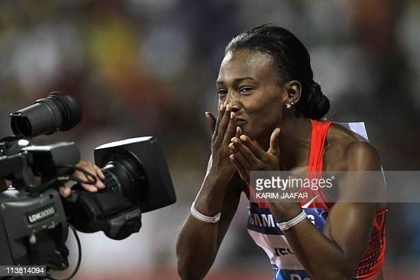 Kellie Wells of the US blows a kiss to a camera after winning the women's 100m hurdles at the IAAF Diamond League in Doha on May 6 2011 AFP...