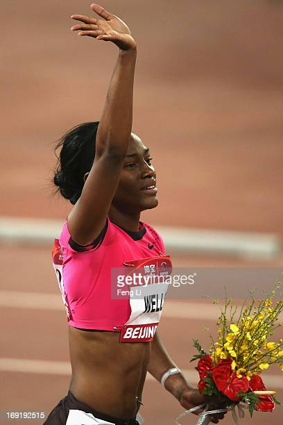 Kellie Wells of United States celebrates after she won the Women's 100 Metres Hurdles at National Stadium also known as Bird's Nest during 2013 IAAF...