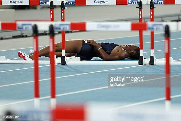 Kellie Wells of United States lies on the floor injured during the women's 100 metres hurdles final during day eight of 13th IAAF World Athletics...