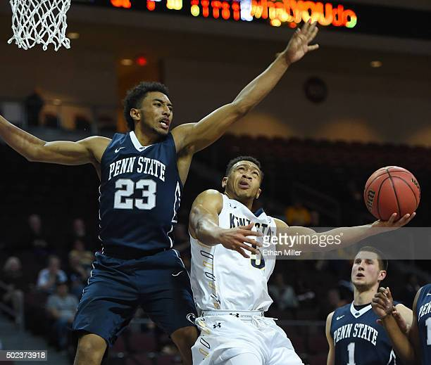 Kellon Thomas of the Kent State Golden Flashes scores on a reverse layup against Josh Reaves of the Penn State Nittany Lions during the 2015...