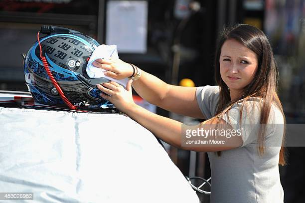 Kelly Admiraal of Canada driver of the Swan Rentals Chevrolet cleans her helmet during practice for the KN Pro Series Autolite Iridum XP150 at Iowa...