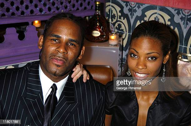 R Kelly and Cat Wilson in the Hennessy Lounge at the BMG GRAMMY after party