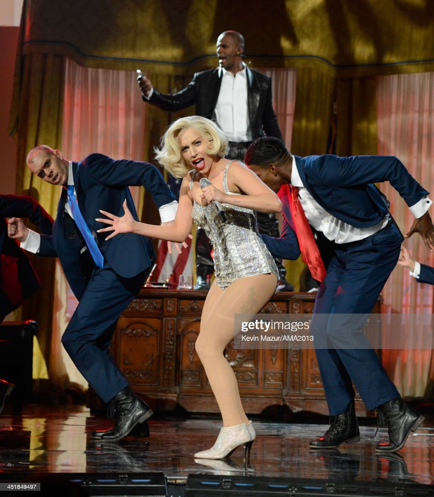 R Kelly and <a gi-track='captionPersonalityLinkClicked' href=/galleries/search?phrase=Lady+Gaga&family=editorial&specificpeople=4456754 ng-click='$event.stopPropagation()'>Lady Gaga</a> perform onstage during the 2013 American Music Awards at Nokia Theatre L.A. Live on November 24, 2013 in Los Angeles, California.