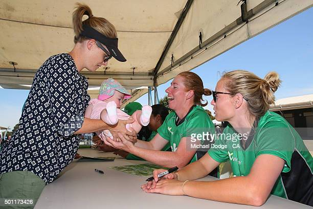 Kelly Applebee of the Stars receives with her daughter Ella from a family member during a signing session at Casey Fields on December 13 2015 in...