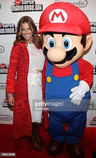 Kelly Bensimon adn Mario attend the 25 years of Mario celebration Super Mario Bros Wii launch at the Nintendo World Store on November 12 2009 in New...