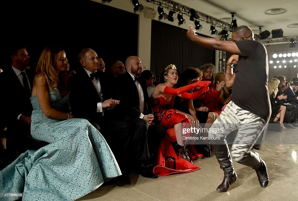 Kelly Bensimon John Demsey and Miley Cyrus sit front row at the 2015 amfAR Inspiration Gala New York at Spring Studios on June 16 2015 in New York...
