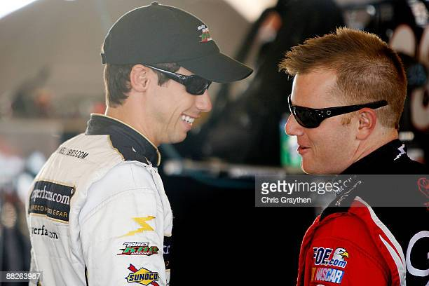 Kelly Bires driver of the Chevrolet talks with Jason Leffler driver of the Great Clips Toyota during practice for the NASCAR Nationwide Series...