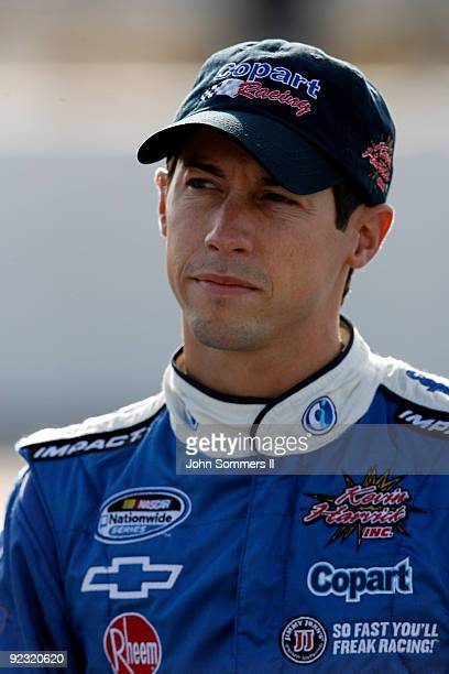 Kelly Bires driver of the Copart Chevrolet stands on the grid during qualifying for the NASCAR Nationwide series Kroger 'On Track For Cure' 250 race...