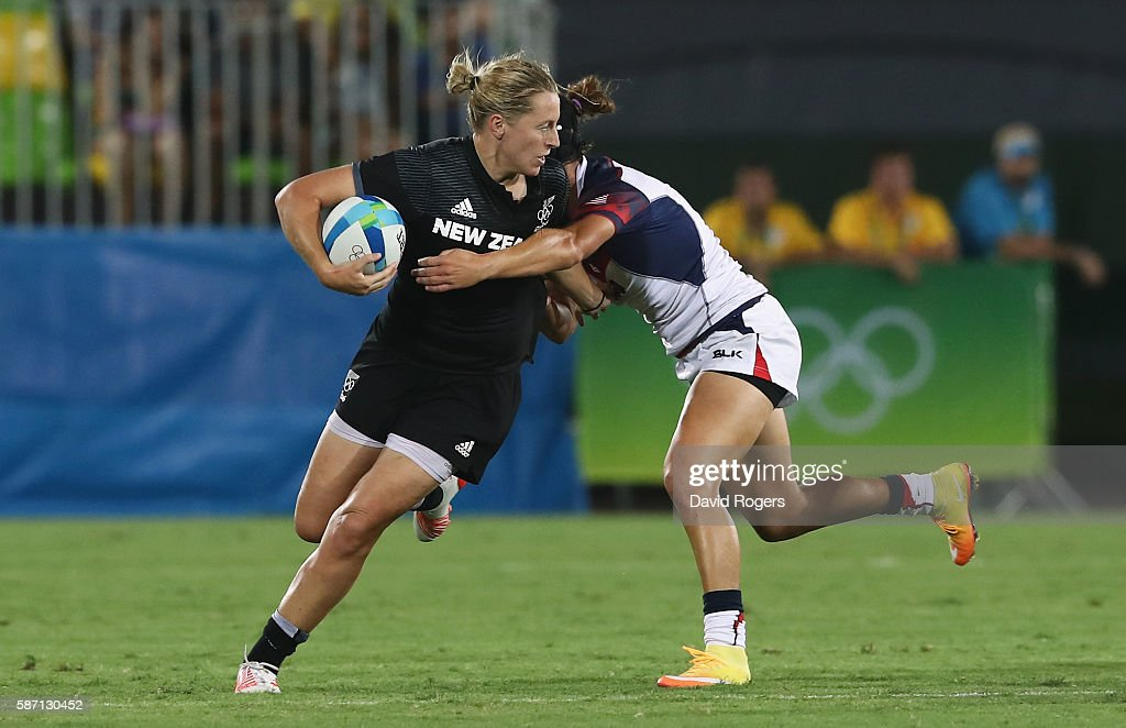 Kelly Brazier of New Zealand carries the ball against Lauren Doyle of the United States in the Women's Quarterfinal rugby match on Day 2 of the Rio...