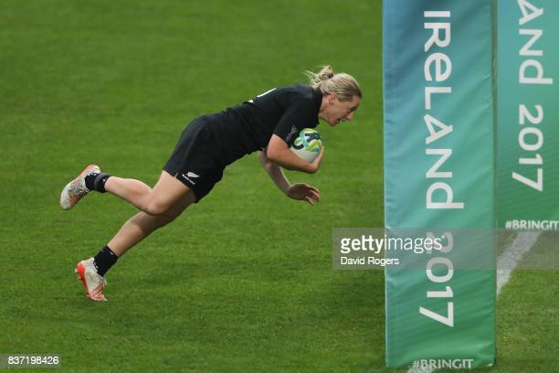 Kelly Brazier of New Zealand dives over to score her team's final try during the Women's Rugby World Cup 2017 Semi Final match between New Zealand...