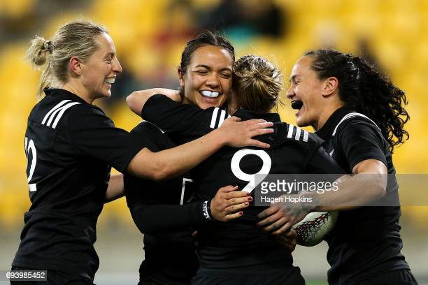 Kelly Brazier Stacey Waaka Kendra Cocksedge and Portia Woodman of New Zealand celebrate Cocksedge's try during the Women's International Test match...
