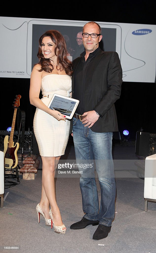 Kelly Brook (L) and Simon Stanford, Vice President, Communications and Networks, Samsung UK and Ireland reveal the Samsung Galaxy Note 10.1 at its London launch event at One Mayfair on August 15, 2012 in London, England.