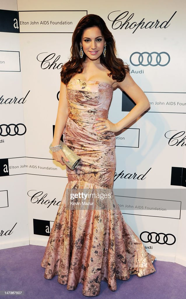 Kelly Brook attends The 14th Annual White Tie and Tiara Ball to Benefit Elton John AIDS Foundation in Association with Chopard at Woodside on June 28, 2012 in Windsor, England. NO UK SALES BEFORE 17TH JULY 2012. NO HELLO, NOW, CLOSER, REVEAL, HEAT, LOOK OR GRAZIA SALES IN THE UK EVER. NO ITALY SALES BEFORE 4TH JULY 2012, NO SPAIN SALES BEFORE 7TH JULY 2012, NO MEXICO SALES BEFORE 1ST AUGUST 2012. All pictures are for editorial use only and mention of 'Chopard' and 'The Elton John Aids Foundation' are compulsory. No sales ever to any jewellers other than Chopard