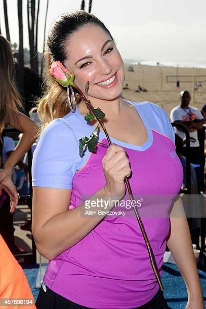 Kelly Brook attends the Skechers Pier to Pier Friendship Walk at Manhattan Beach Pier on October 26 2014 in Manhattan Beach California