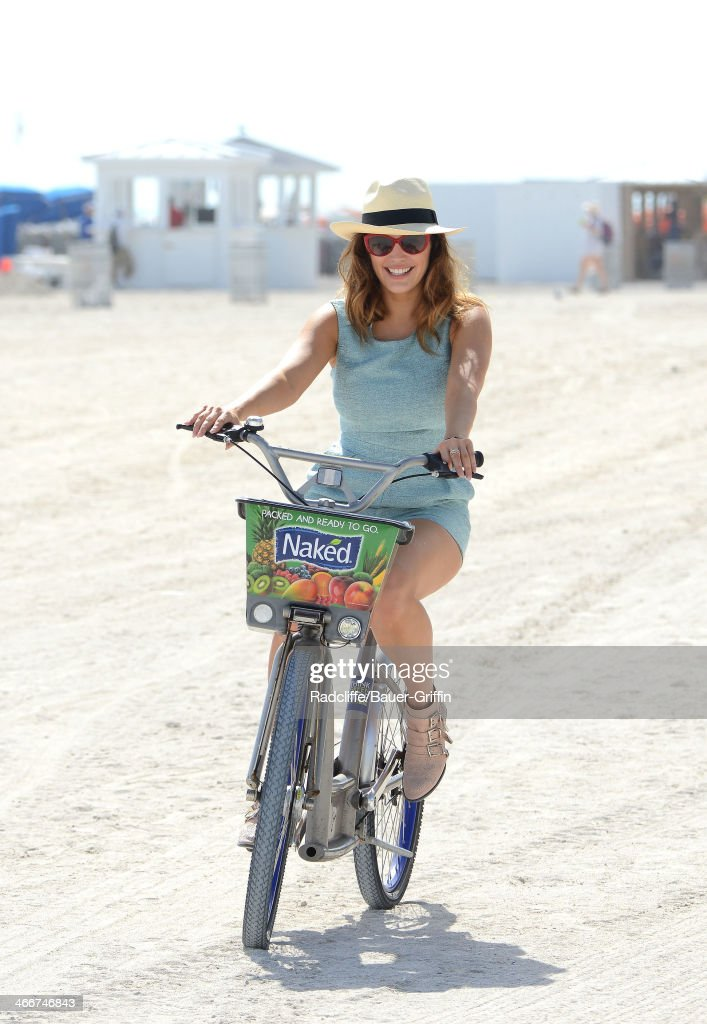 <a gi-track='captionPersonalityLinkClicked' href=/galleries/search?phrase=Kelly+Brook&family=editorial&specificpeople=206582 ng-click='$event.stopPropagation()'>Kelly Brook</a> is seen riding a bike on the beach on February 03, 2014 in Miami, Florida.