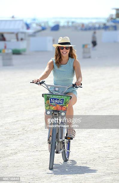 Kelly Brook is seen riding a bike on the beach on February 03 2014 in Miami Florida