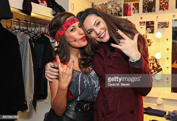 Kelly Brook poses with cast member Preeya Kalidas backstage at the West End production of 'School Of Rock The Musical' at The New London Theatre...