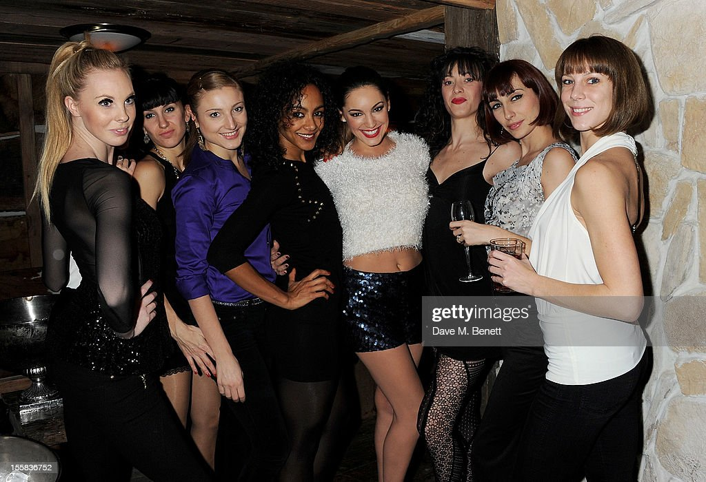 <a gi-track='captionPersonalityLinkClicked' href=/galleries/search?phrase=Kelly+Brook&family=editorial&specificpeople=206582 ng-click='$event.stopPropagation()'>Kelly Brook</a> (C) poses with the Crazy Horse performers at a party at Piers Adam's new restaurant Bodo's Schloss on High Street Kensington on November 8, 2012 in London, England.