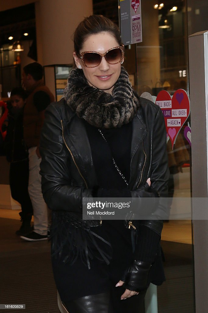 Kelly Brook seen shopping at Selfridges on February 13, 2013 in London, England.