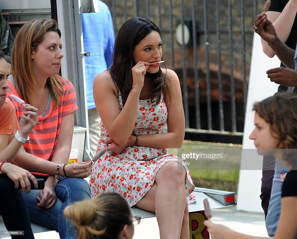 <a gi-track='captionPersonalityLinkClicked' href=/galleries/search?phrase=Kelly+Brook&family=editorial&specificpeople=206582 ng-click='$event.stopPropagation()'>Kelly Brook</a> (C) sighted enjoying an ice cream in between takes whilst filming on July 5, 2013 in London, England.