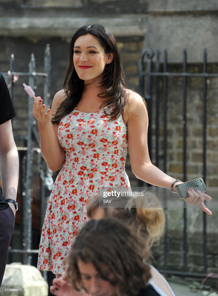 Kelly Brook sighted enjoying an ice cream in between takes whilst filming on July 5, 2013 in London, England.
