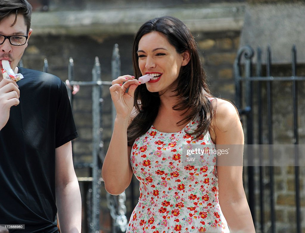 <a gi-track='captionPersonalityLinkClicked' href=/galleries/search?phrase=Kelly+Brook&family=editorial&specificpeople=206582 ng-click='$event.stopPropagation()'>Kelly Brook</a> sighted enjoying an ice cream in between takes whilst filming on July 5, 2013 in London, England.